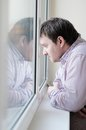 Man looking at the window Royalty Free Stock Image