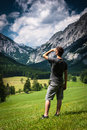 Man looking young on field in mountains forward Royalty Free Stock Photography