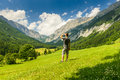 Man looking young on field in mountains forward Stock Image