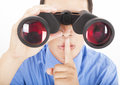 Man looks through binoculars Stock Images