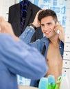 Man looks himself at mirror while preparing for job Royalty Free Stock Photo