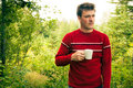 Man lost in nature with a mug of coffee Royalty Free Stock Photo