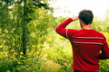 Man lost in nature and trying to find the way back home Royalty Free Stock Image
