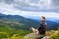 Man and loyal friend dog look side one watching the beautiful pensive dreamy magical mountain landscape time for reflection Stock Images