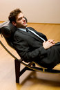 Man lying on chaise longue Royalty Free Stock Photography