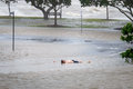Man lying in floodwaters brisbane qld australia january lies flood water brisbane during the floods of january Royalty Free Stock Photography