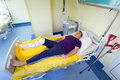 Man lying in hospital after surgery arthroscopic Royalty Free Stock Photography