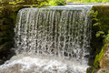 Man made waterfall fed by small lake on scottish estate Royalty Free Stock Photos