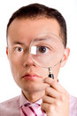 Man with magnifying glass Stock Photography