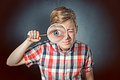 Man with magnifying glass examines something Royalty Free Stock Images