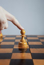 Man makes a move chess pawn hand of making figure Stock Photography