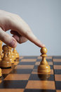 Man makes a move chess pawn hand of making figure Royalty Free Stock Photo
