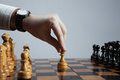 Man makes a move chess pawn hand of making figure Stock Image