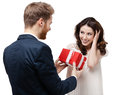 Man makes present to his sweetheart Stock Photos
