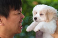 Man making angry face at maltese puppy cute Stock Image
