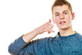Man making call me gesture phone hand sign communication concept young blonde teen boy with isolated on white Royalty Free Stock Images