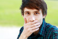 Man making face young and cover his mouth by his palm Royalty Free Stock Photo