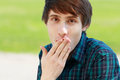Man making face young and cover his mouth by his palm Stock Photography