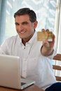 Man making online purchases portrait of middle ages purchasing goods Stock Photography