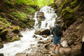 Man making photos of the waterfall in the forest Royalty Free Stock Photo