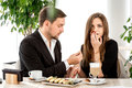Man making proposal to his girlfriend at the with ring restaurant shocked and surprised woman Stock Photos