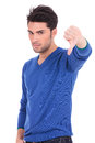 Man making the thumbs down negative hand sign young casual on white background Stock Photography