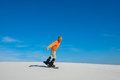 Man making a trick on snowboard on sand slope Royalty Free Stock Photo
