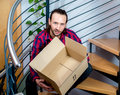 Man man sitting in corridor with a empty box Royalty Free Stock Photo