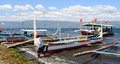 A man with many boats at the jetty in Tagaytay, Philippines Royalty Free Stock Photo