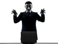 Man masked anonymous group member computing computer menacing si paris– october one dressed and as a of underground on Stock Photography