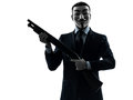 Man masked anonymous group memeber holding shotgun silhouette po Royalty Free Stock Images