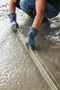 Man mason building a screed coat cement Royalty Free Stock Photo