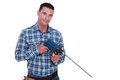 Man with a masonry drill powerful Stock Image