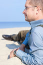 Man mature lying sand sea relax baltic Royalty Free Stock Photos