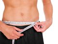 Man measuring his waistline closeup of young clenching fist Royalty Free Stock Images