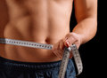 Man is measuring waist with centimeter tape Royalty Free Stock Photo