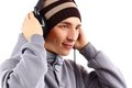 Man med hörlurar som lyssnar till musik Fotografering för Bildbyråer