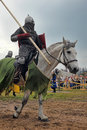Man in a medieval historical clothes on horseback Royalty Free Stock Photo