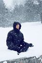 Man meditates in the lotus position a young on snow Royalty Free Stock Photo