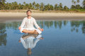 Man meditating doing yoga asana in a lotus position Royalty Free Stock Photos