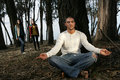 Man meditating in forest Stock Images