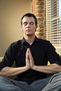 Man in meditation pose Stock Image