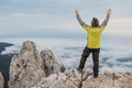 Man meets the new day on top of mountain Stock Photo
