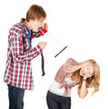 Man with megaphone screaming on his girlfriend Royalty Free Stock Images