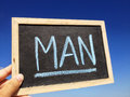 Man men cyan blue write word big Royalty Free Stock Photo