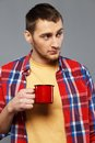 Man with a metal mug Royalty Free Stock Photos