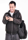 A man with mobile phones and carry bag isolated on white background Royalty Free Stock Images