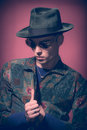 Man model, looking down, hat fashion photography Royalty Free Stock Photo