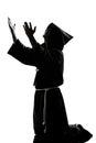 Man monk priest silhouette praying Royalty Free Stock Photography