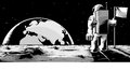 Man on the moon an astronaut standing surface looking back at earth rising Stock Photo